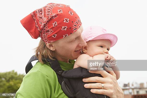 father carrying baby outdoors - leanintogether stock pictures, royalty-free photos & images
