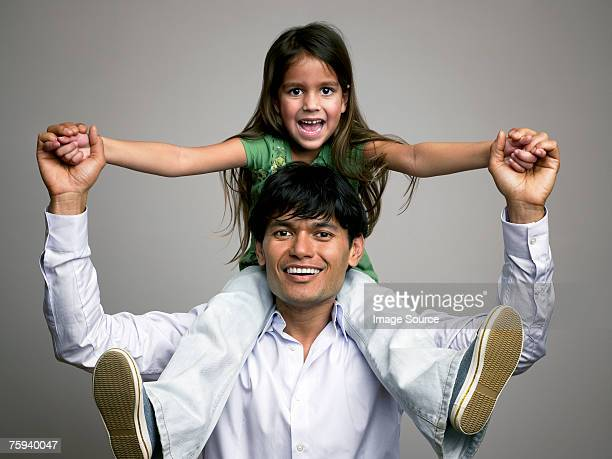 father carrying daughter - carrying a person on shoulders stock photos and pictures