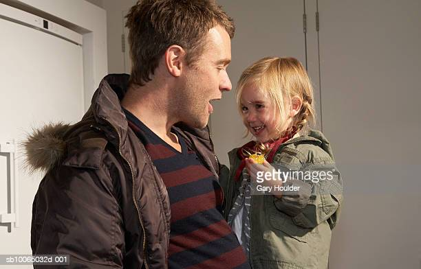 father carrying daughter (21-24 months) - parka coat stock photos and pictures