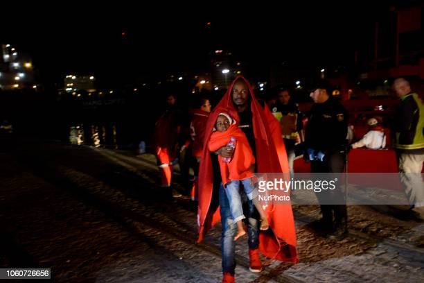 A father carrying his young son from the vessel to the bus Malaga The Maritime Spanish Vessel SAR Mastelero rescued three dinghies with a total 139...