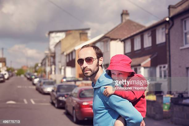 father carrying young son - piggyback stock pictures, royalty-free photos & images