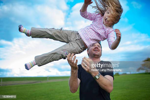 Father catching his daughter in air, Australia