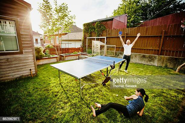 father celebrating point during ping pong game - funny ping pong stock pictures, royalty-free photos & images