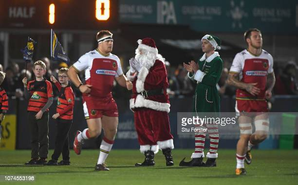 Father Christmas and Elf greet the players before the Gallagher Premiership Rugby match between Worcester Warriors and Northampton Saints at Sixways...