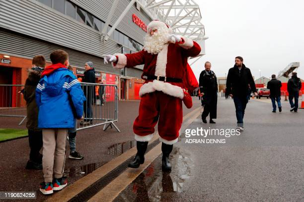 Father Christmas appears outside the stadium before the English Premier League football match between Southampton and Crystal Palace at St Mary's...