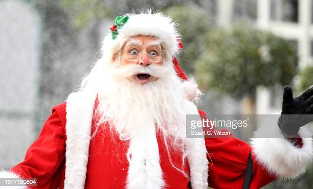 Father Christmas arrives ahead of Prince William Duke of Cambridge and Catherine Duchess of Cambridge as they host a Christmas party to deliver a...