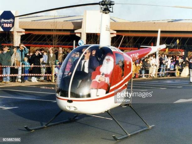 Father Christmas arriving in style in a helicopter at the car park of Homestyle by FADS Teesside 28th November 1992