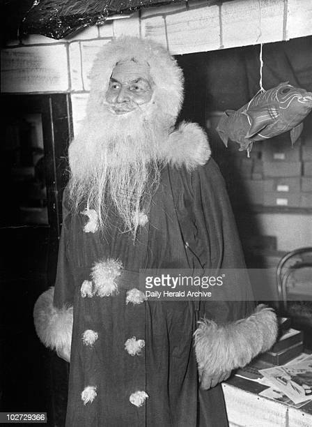 Father Christmas at Quinn and Axtens store in Brixton London 5 December 1934 Photograph by Tomlin Father Christmas at Quin and Axtens store in...