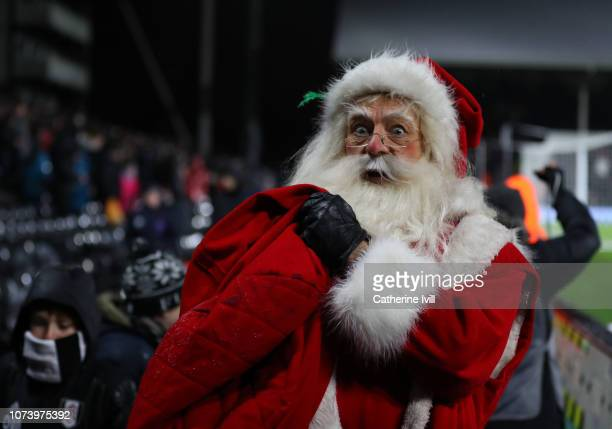 Father Christmas during the Premier League match between Fulham FC and West Ham United at Craven Cottage on December 15 2018 in London United Kingdom