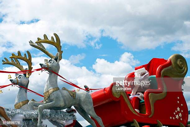 father christmas in his sleigh at the richmond santa parade - parade stock pictures, royalty-free photos & images