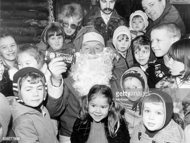 Father Christmas in John Walker Square listening to the wishes of all the little children hoping for that special present in their stocking,...