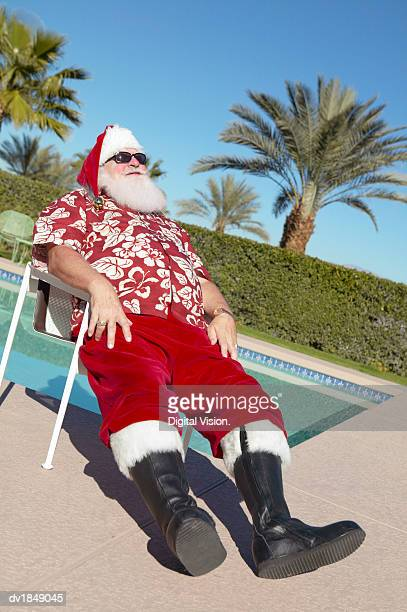 Father Christmas on Holiday Relaxing Poolside