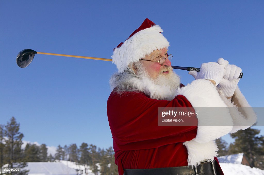 Father Christmas Playing Golf in the Snow : Stock Photo