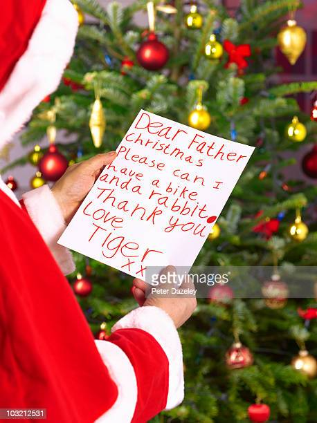 Father christmas reading child's letter