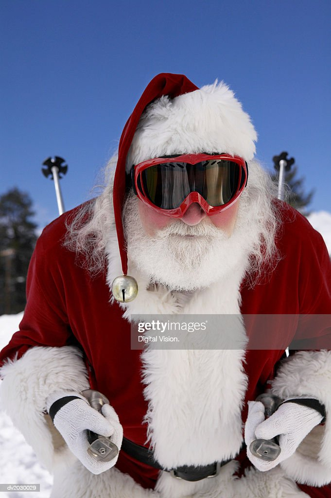 Father Christmas Skiing on a Ski Slope : Stock Photo