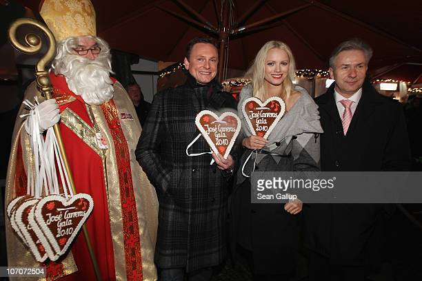 Father Christmas television host Axel Bulthaupt model Franziska Knuppe and Berlin Mayor Klaus Wowereit attend the official opening of the Christmas...