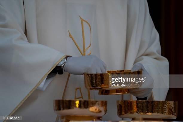 Father Christoper Williams of the Basilica of San Albino performs the Eucharist during an outdoor mass on May 2, 2020 in Mesilla, New Mexico, amid...