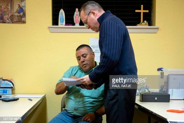 Father Christopher Williams goes over travel arrangements with Deacon Leonel Briseno at the Basilica of San Albino in Mesilla New Mexico on January 2...