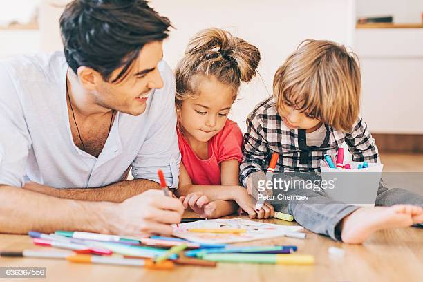 Father coloring pages with his two small children