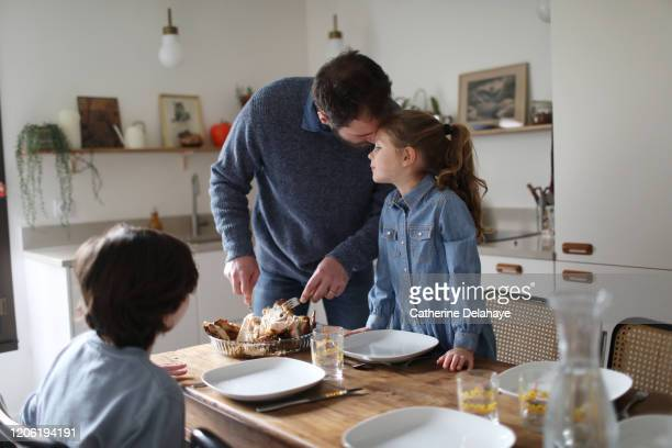a father cooking with his children in the kitchen - lunch stock pictures, royalty-free photos & images