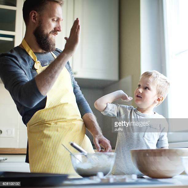 Father cooking with his son