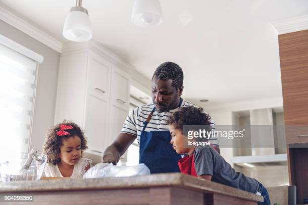 Father cooking with kids