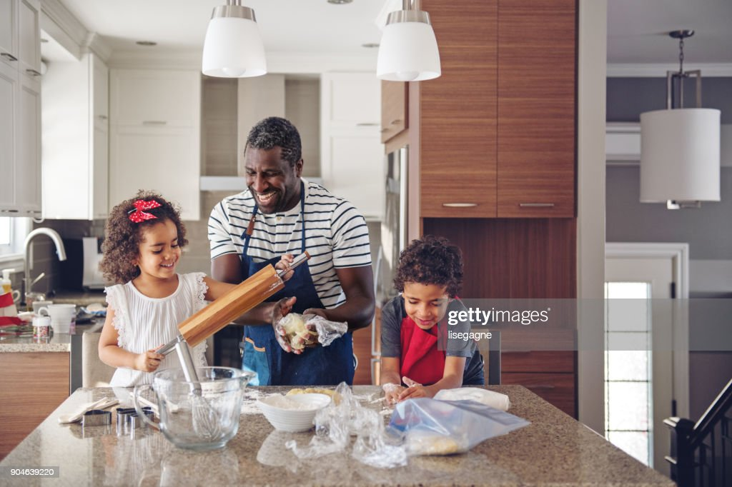 Father cooking with kids : Stock Photo