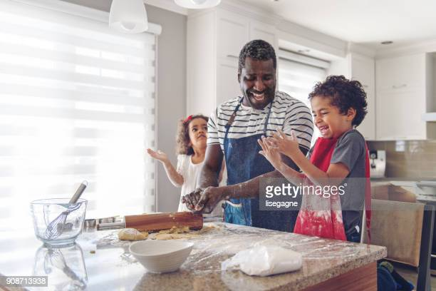 father cooking with kids - family stock pictures, royalty-free photos & images