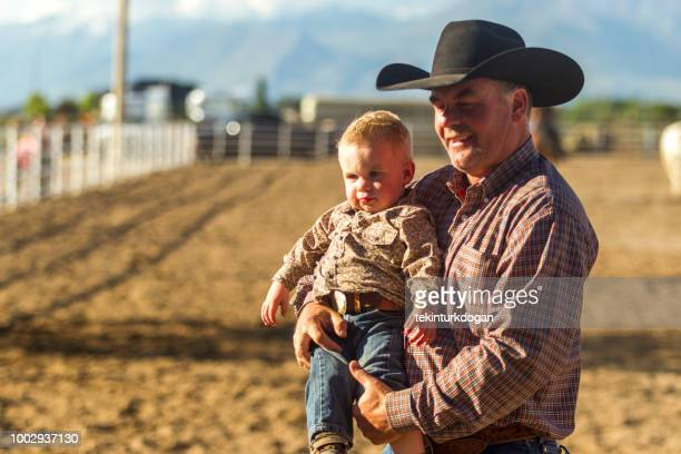 father cowboy with baby son at farm ranch near santaquin salt lake city slc utah usa - spanish fork utah stock pictures, royalty-free photos & images
