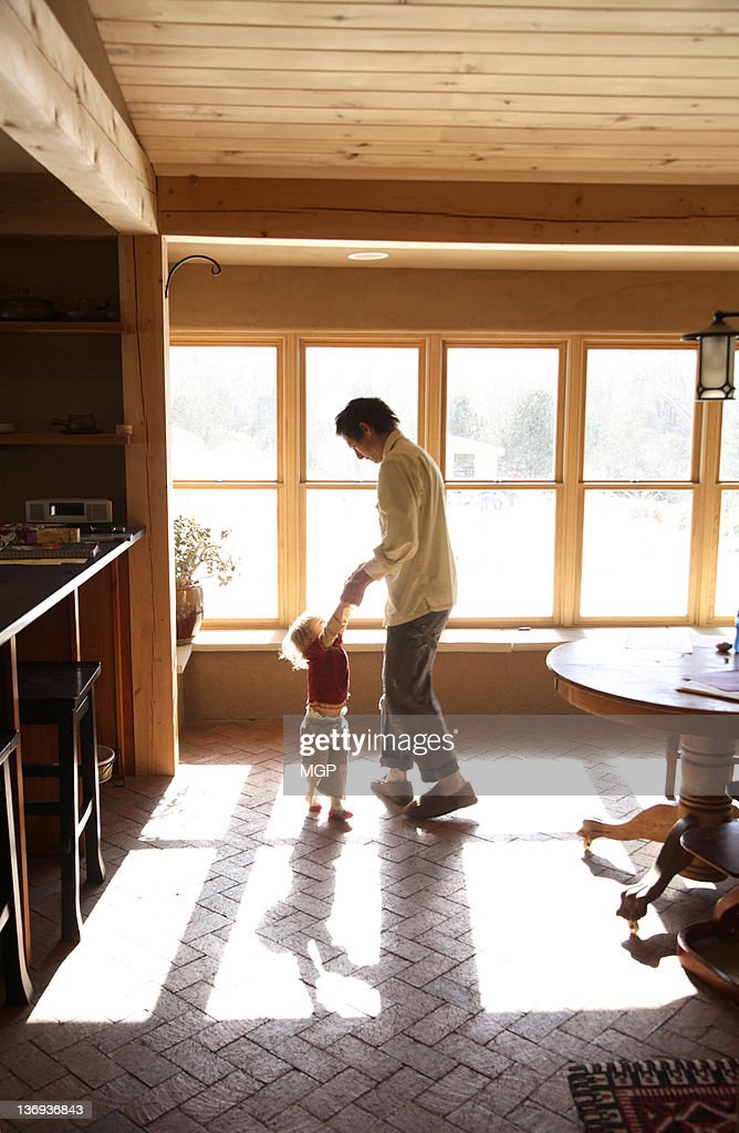 Father dances with young daughter : Stock Photo