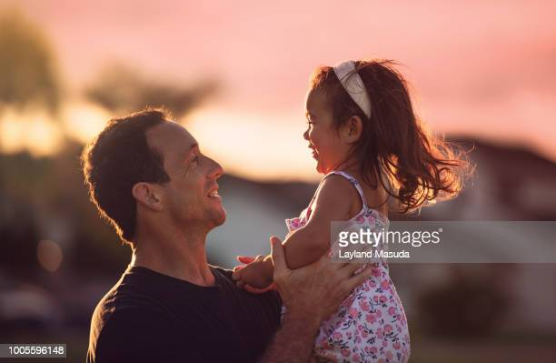 father daughter joy - twilight stock pictures, royalty-free photos & images
