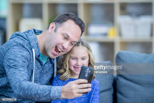 father daughter selfie at home - fatcamera stock pictures, royalty-free photos & images