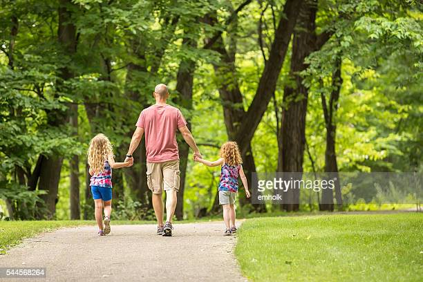 Father & Daughters Walking on Park Trail in Summer
