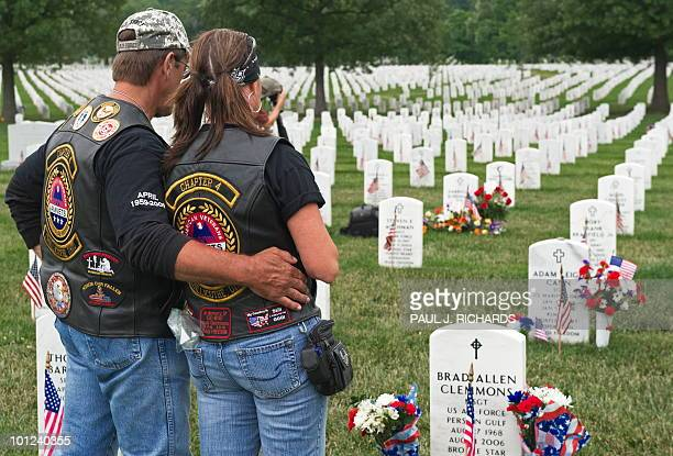 Father David Clemmons and unidentified friend stand at the gravesite in Arlington National Cemetery of his son May 28 2010 US Air Force Master Sgt...