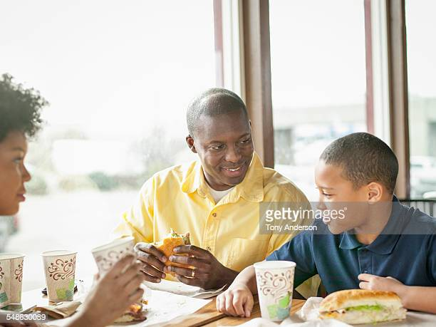 Father dining out with daughter and son
