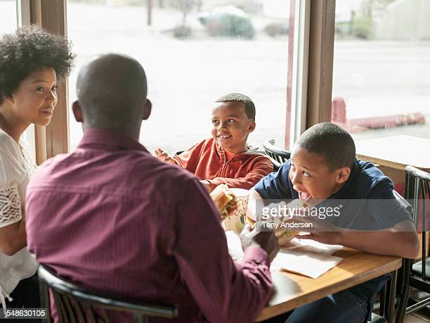 Father dining out with daughter and two sons