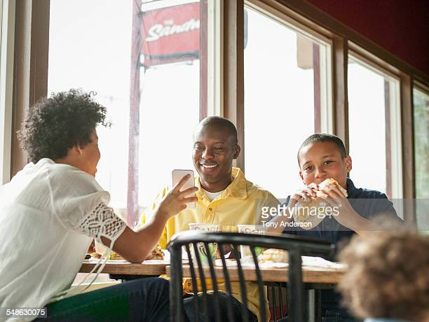father dining out with family - leanintogether stock pictures, royalty-free photos & images