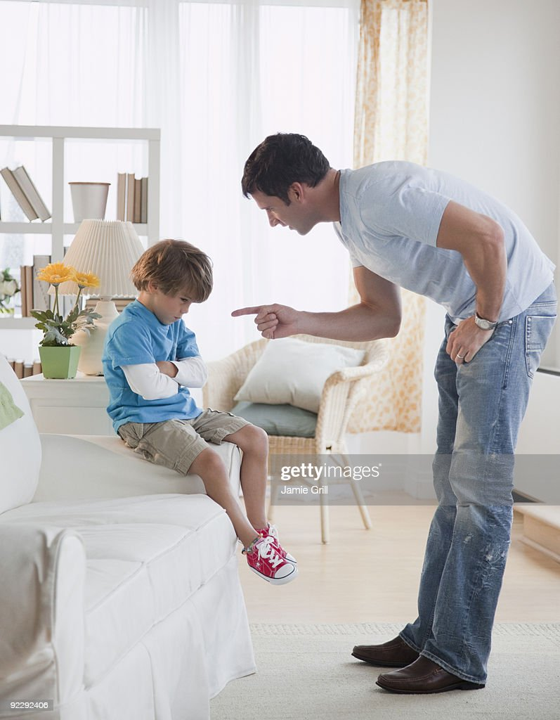 Father disciplining son : Stock Photo