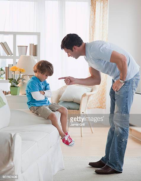 Father disciplining son