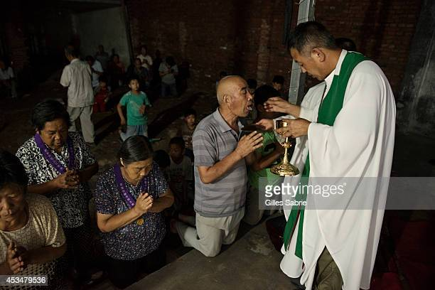 Father Dong an 'underground' Catholic priest who has so far refused to join the Chinese Patriotic Catholic Association unlike most catholic clerics...