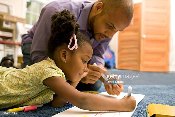 Father drawing with daughter