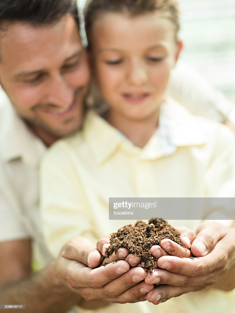 father educate son to care a plant : Stock Photo