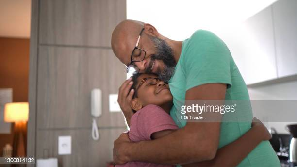 father embracing son at home - i love you stock pictures, royalty-free photos & images