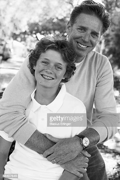 father embracing son - blasius erlinger stock pictures, royalty-free photos & images