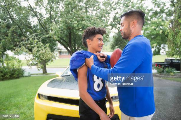 Father encouraging his teen son