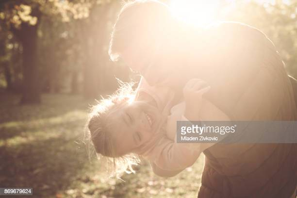 Father enjoying in spring day with daughter. Close up.