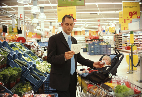 Father feeding baby daughter (12-15 months) in supermarket - gettyimageskorea