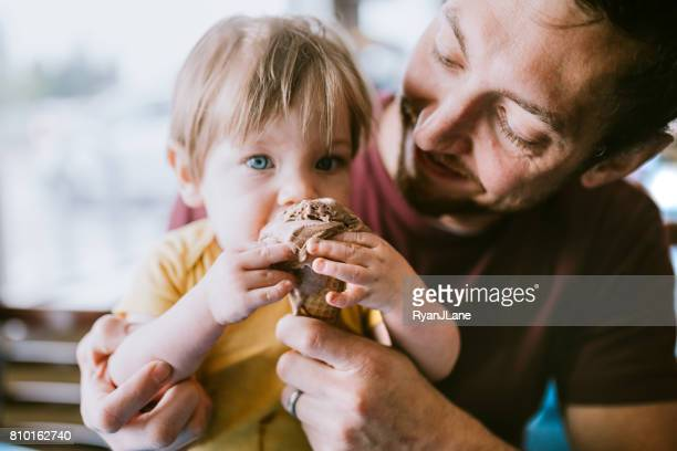 Father Feeding Baby Ice Cream Cone