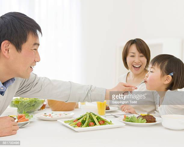 Father Feeding His Daughter