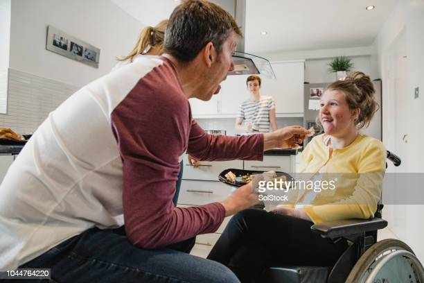 Father Feeding his Disabled Daughter Lunch